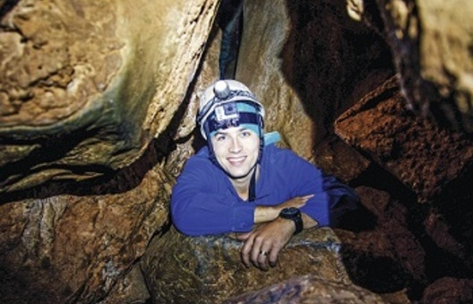 A man doing a tour in the world heritage Jenolan Caves in the Blue Mountains