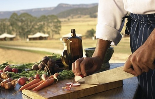 a chef preparing food at a resorts in the Blue Mountains.