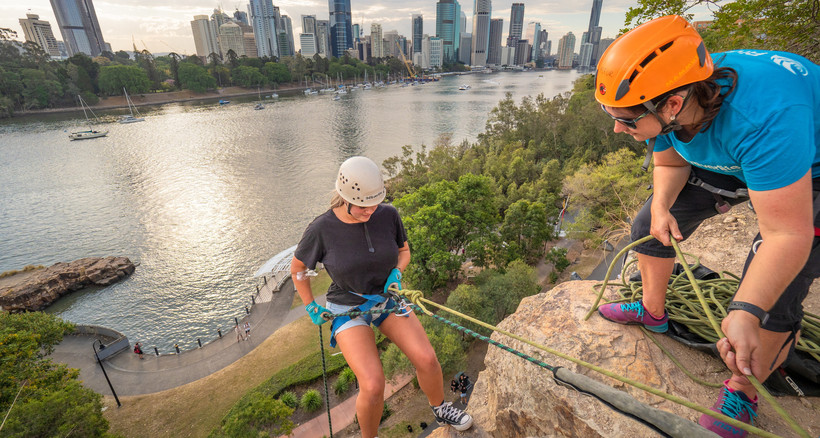 a couple of women doing an abseiling tour down Kangaroo Point in Brisbane