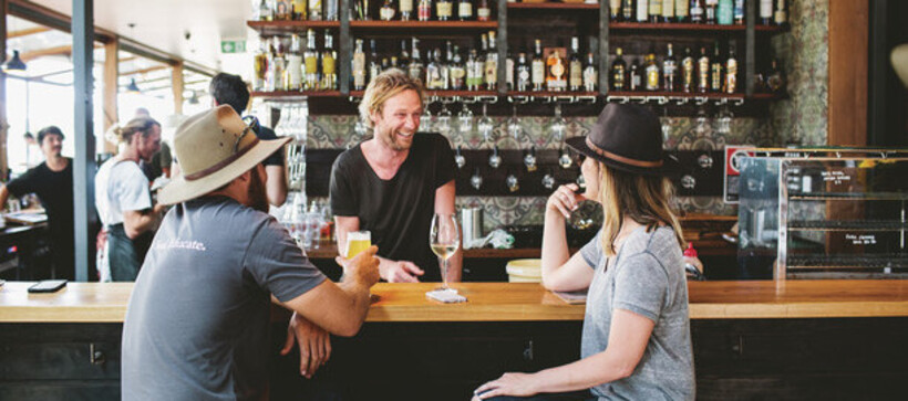People enjoying a drink at the Three Blue Ducks at The Farm in Byron Bay