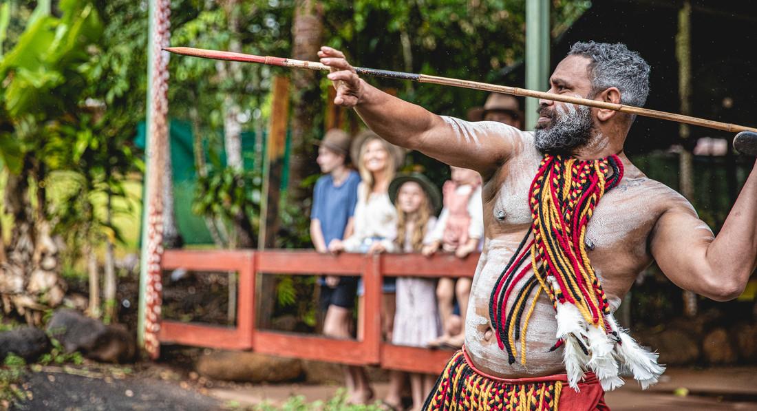 an Aboriginal man throwing a spear at theTjapukai Aboriginal Cultural Park