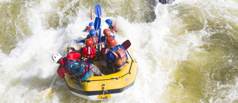 a group of people white water rafting on the Barron River.