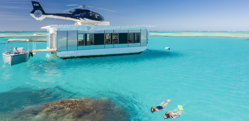 people enjoying a snorkelling tour off the pontoon boat on the Great Barrier Reef