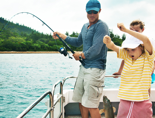 A dad and his kids Barramundi fishing in Cairns.