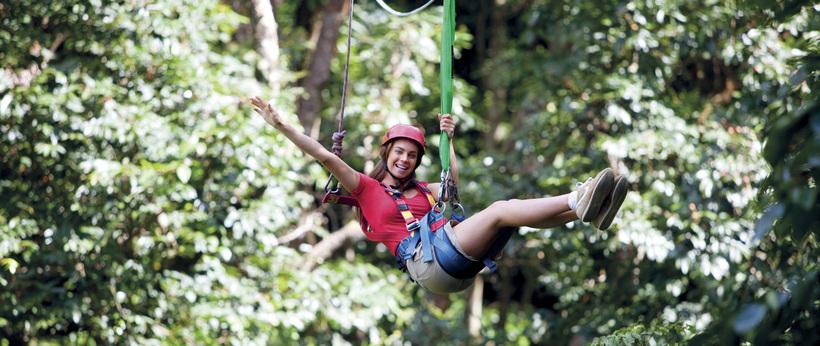 a woman Ziplining through the Daintree rainforest