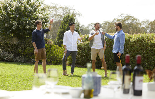 a group of men playing croquet and sipping wine in theHunter Valley