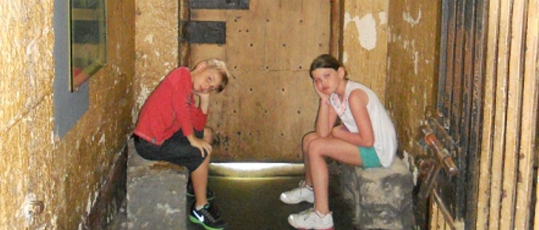 two children experiencing one of the gaol cells at the old Melbourne Gaol