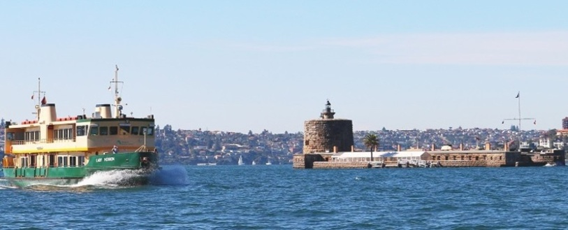 a ferry going past Fort Dennison which is an island in the middle of Sydney Harbour