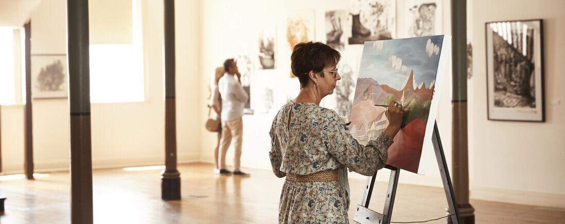 artist Amanda Johnson at work at the Broken Hill Regional Art Gallery.