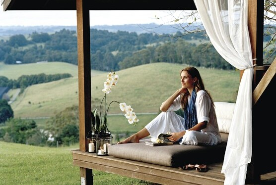 A woman relaxing & unwinding at a Byron Bay resort