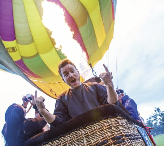 a man in a hot air balloon in the Hunter Valley
