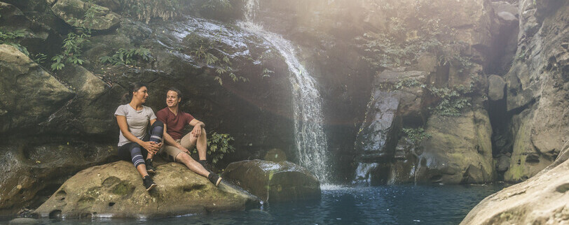 a couple hiking to Cascade Falls in Macquarie Pass National Park