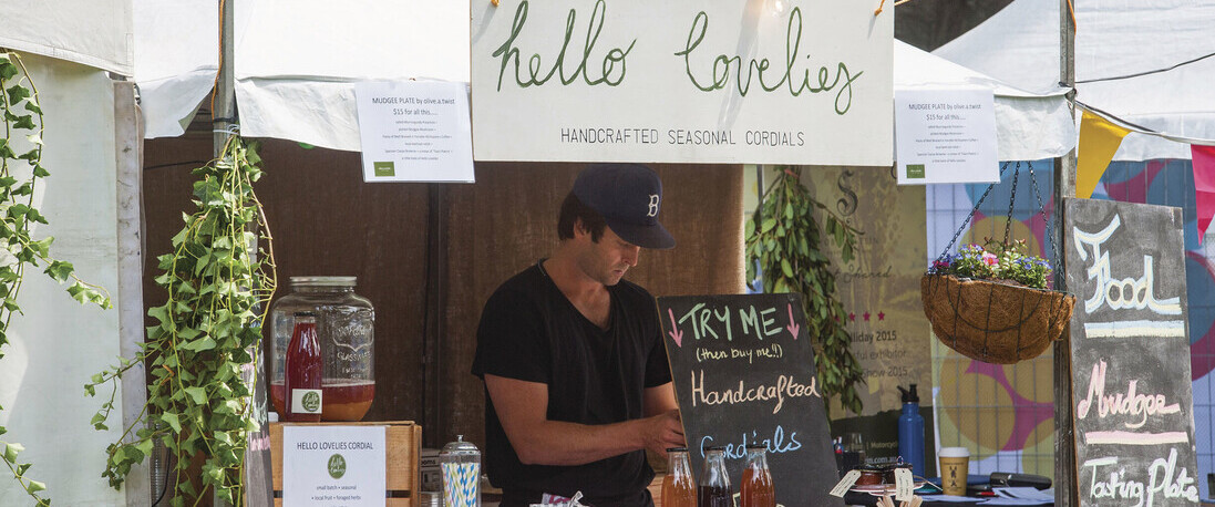 A man making home-made cordial at the Farmers Markets in Mudgee