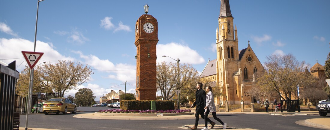 A couple walking through Mudgee town centre in New South Wales