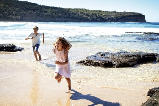 Children running and playing on the beach on the NSW South Coast.