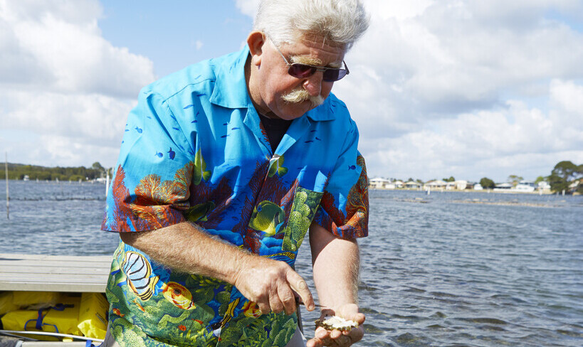 Jim Wilde opening freshly oysters at Greenwell Point.