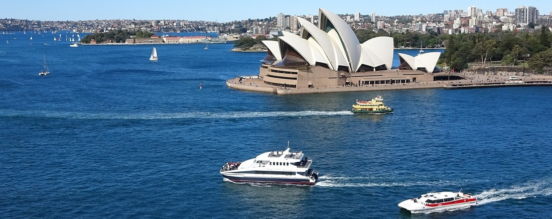boats and ferries on Sydney harbour with the Sydney Opera House in the background