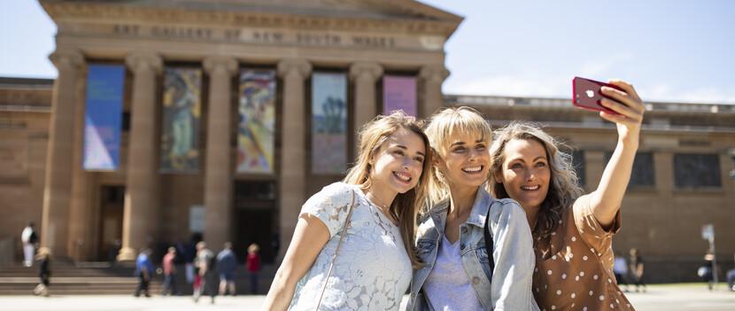 Friends taking a selfie outside NSW Art Gallery in Sydney