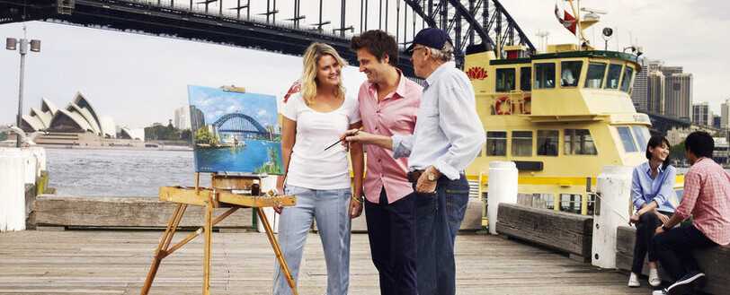 A couple talking with an artist at Circular Quay