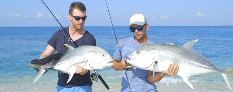 two men showing off the fish they caught on their fishing trip at Garrthalala Island in Arnhem Land.