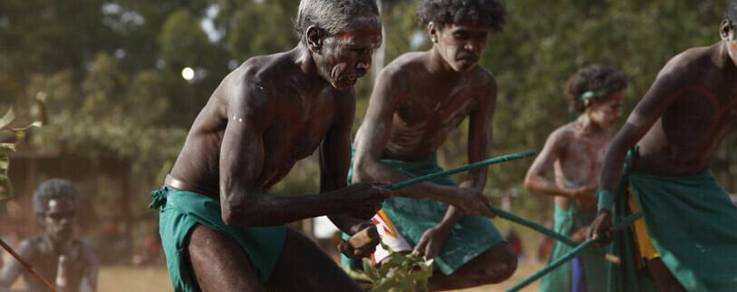Aboriginal men doing a ceremonial dance at the annual Garma Festival