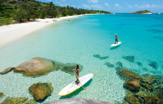 people paddleboarding around Lizard Island.