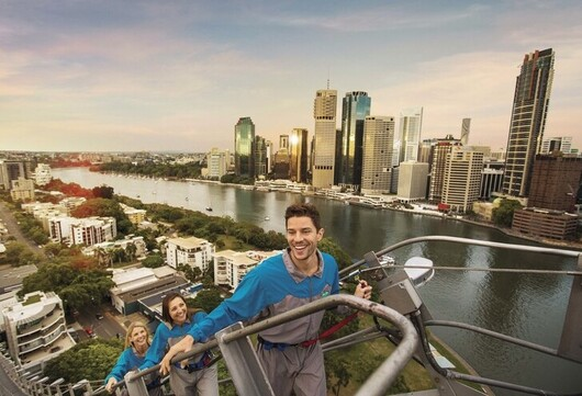 people climbing to the top of the Storey Bridge in Brisbane, as part of a BridgeClimb tour