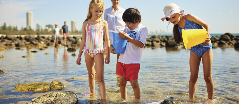 children playing in the Gold Coast creeks and building sandcastles.