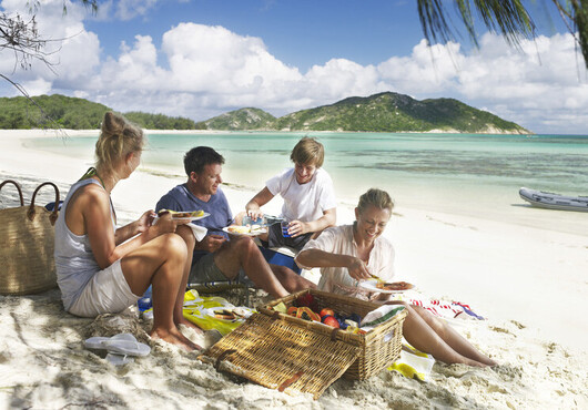 a group of people enjoying a picnic at Michelmas Cay in the Whitsundays