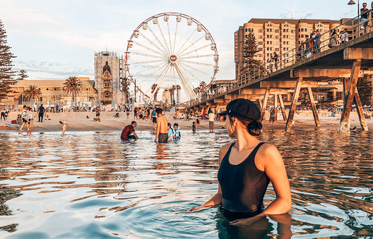 A woman in the water at Glenelg beach in Adelaide