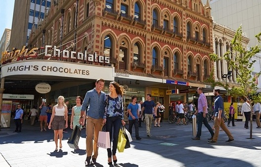 People walking around Adelaide Mall with Haigh's chocolate shop in the background