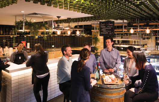 A group of friends having a drink at the National Wine Centre in Adelaide