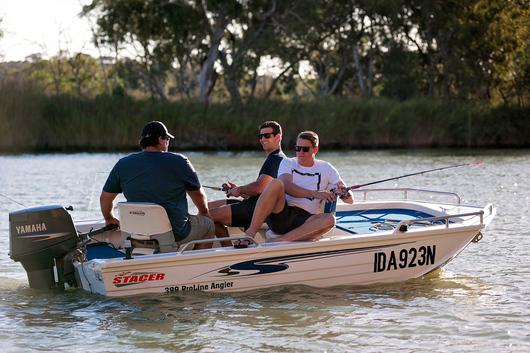 three men fishing along the Murray River.