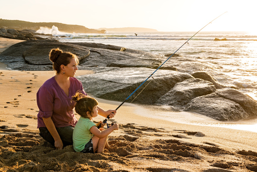 a woman and her child fishing on Browns Beach