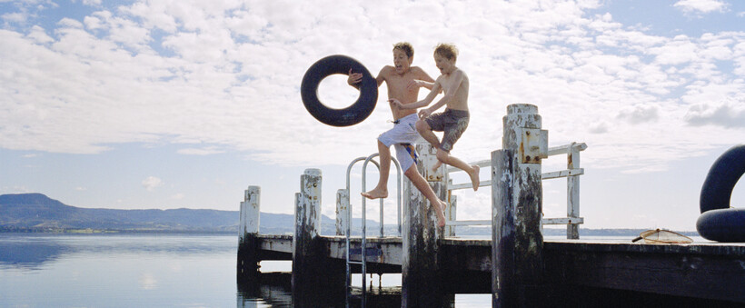 Kids jumping off the wharf and playing in the South Coast's Lake Illawarra