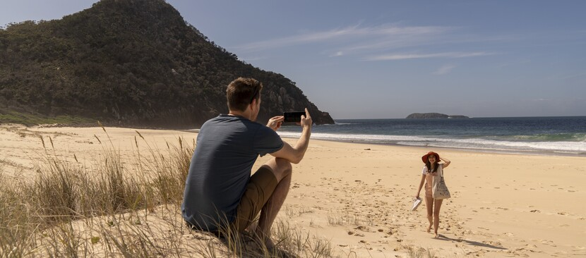 a couple playing andfrolicking on the South Coast beaches.