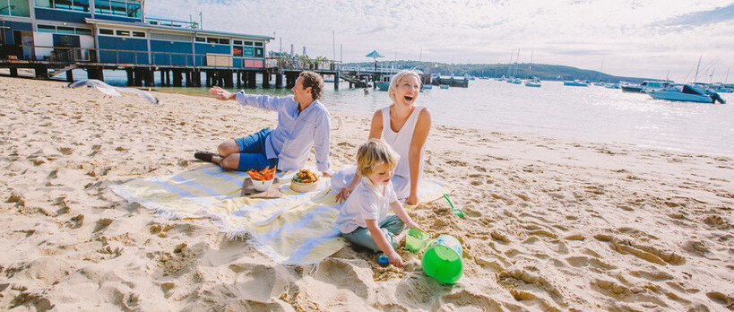 family relaxing on Balmoral beach in Sydney