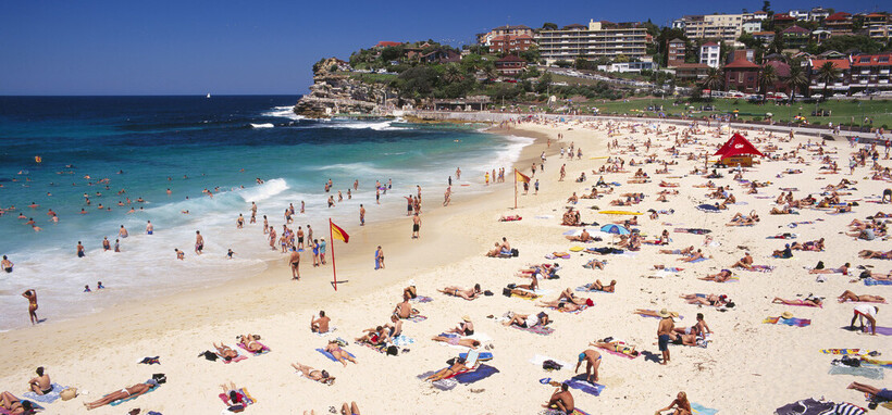 Aerial photo of many people swimming and playing on Bondi beach
