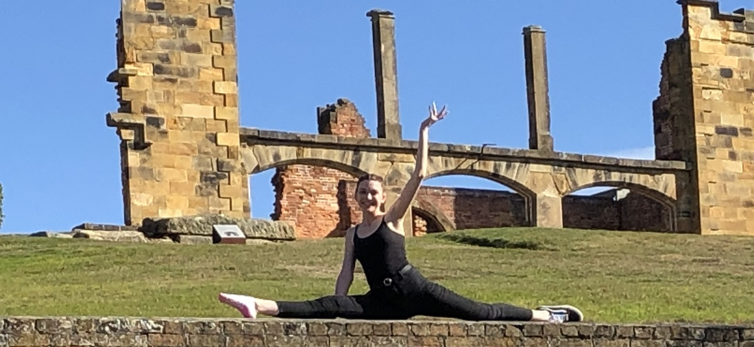 a girl doing the splits on one of the relics atPort Arthur