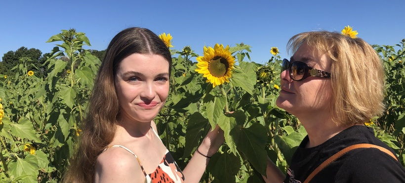 a mother and daughter in the sunflower fields at Farm & Co. at Kingscliff