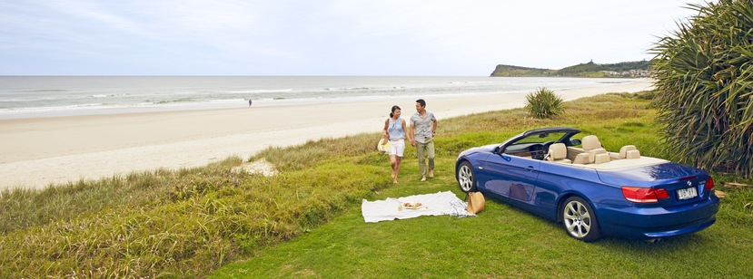a couple having a picnic on the beach.