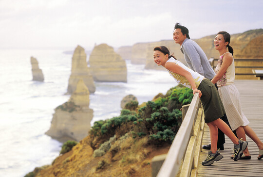 a group of friends at one of the lookouts along the Great Ocean Road. They are getting a great view of the Twelve Apostles.
