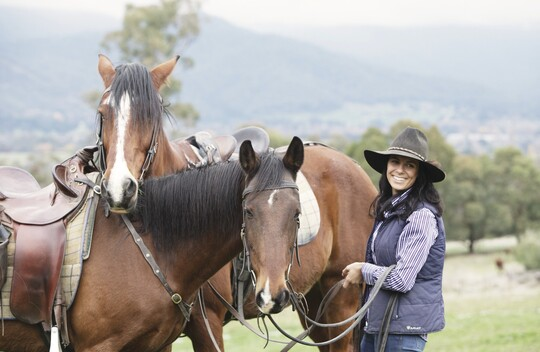 a woman and her horses in the High Country.