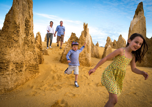 A family running and playing around the Pinnacles in Namburg National Park