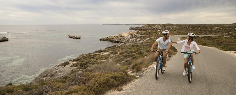 a couple cycling around Rottnest Island