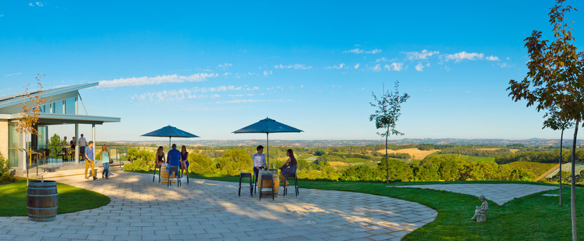 People sipping wine at one of the vineyards in the Swan Valley