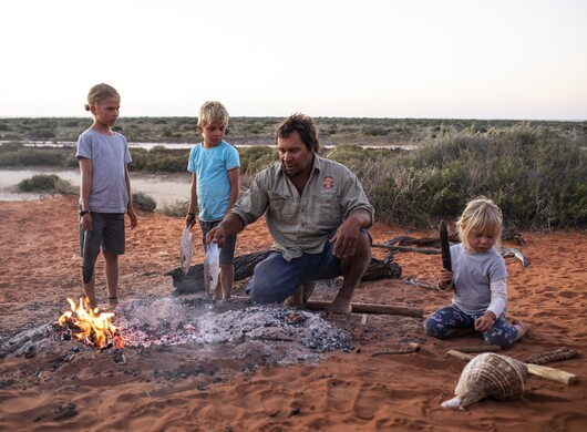 Kids learning how to cook their on fish as part of theirWula Gura Nyinda Eco Adventurein Shark Bay.