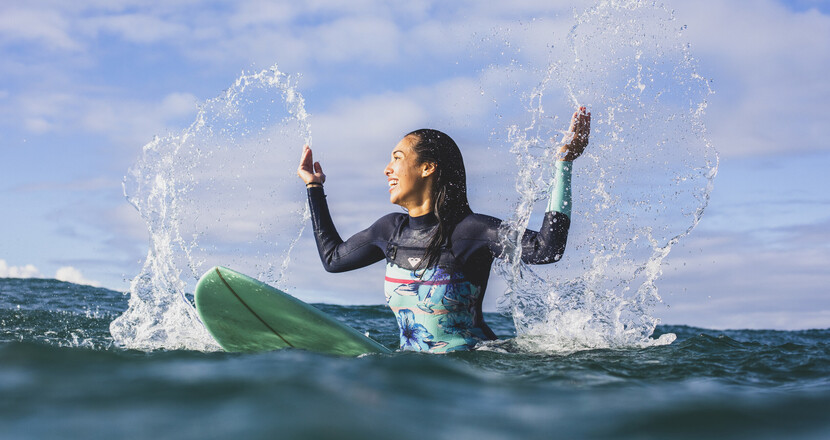 A woman on a surfboard in the ocean on the NSW North Coast.
